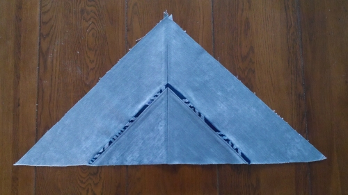 6. Two triangles joined together to make half the cover front